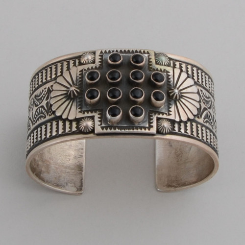 Sterling silver cuff with traditional Four Directions.