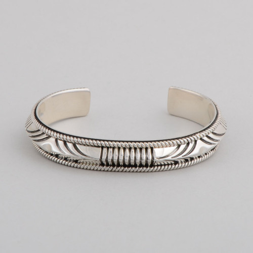 Henry Chackee for Artie Yellowhorse, presents a beautiful, slender sterling silver cuff.