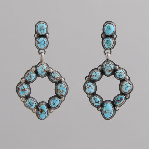 This pair of earrings features # 8 Spiderweb Turquoise set in Sterling Silver.