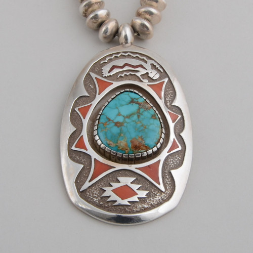 Michael Perry created a magnificent pendant and beads to show it off!  The inlay work on the pendant and the beads is flawless.