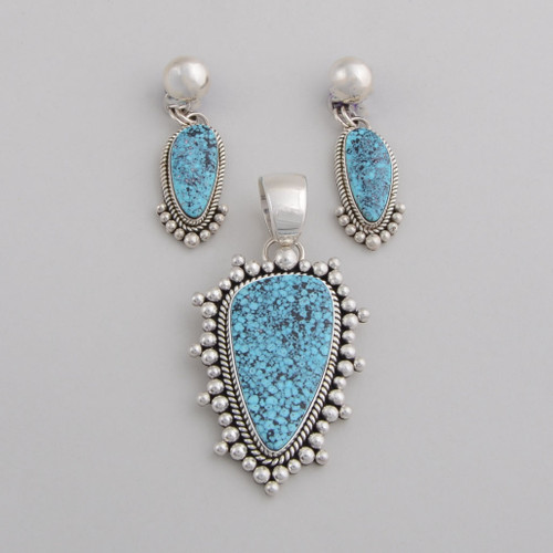 Artie Yellowhorse  spiderweb Turquoise pendant and earring set.
