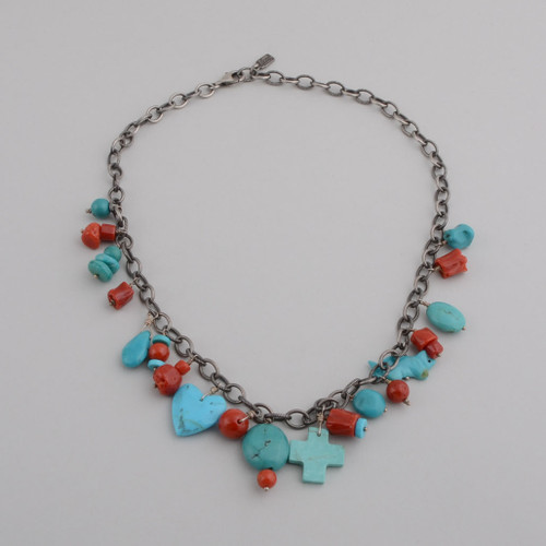 This Peyote Bird necklace is a single strand with Turquoise and coral and small charms.