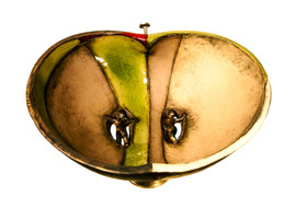 """A view of the Adam & Eve bowl from above, front. The shape is visible, including the brass """"stem"""" - it is a halved apple-inspired shape!"""