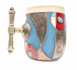 """View of entire mug in all its splendor - imagine the impression such a fine chalice can inspire. This is the example of the general form of the Blue Sky mugs; each piece does have some distinguishing features, whether it be a different handle, text stamp, or contour to the design, each is a unique piece. Pictured is option """"DE"""""""