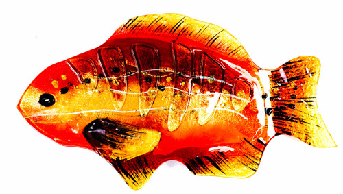 View from above the decorative fused glass fish plate. The reds, yellows, and oranges; translucent and vibrant, add to the visual appeal of any poisson - grille ou frit ou cuit - and any occasion; a social meal or a solitary culinary experience.
