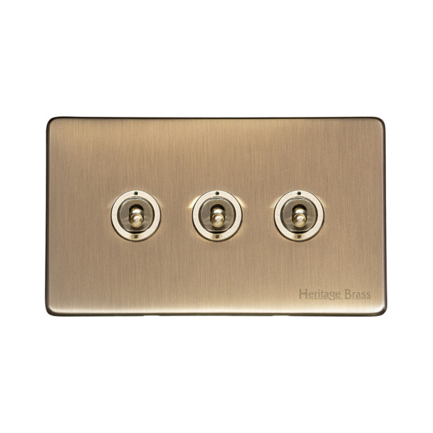 Studio Range 3 Gang Dolly Switch in Antique Brass - Trimless - Y91.2420.AB