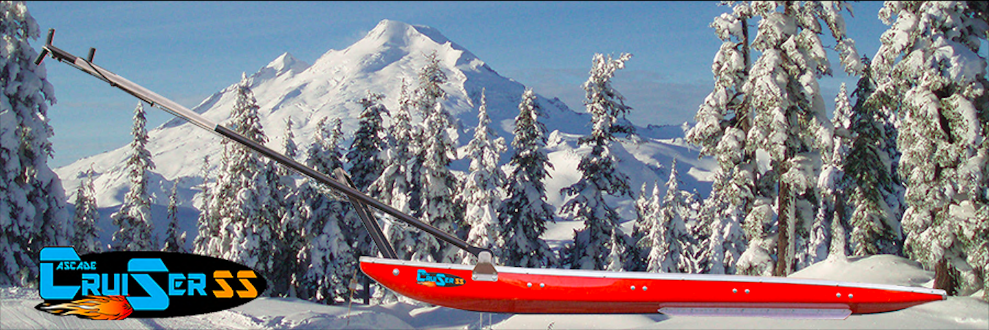 Rescue toboggan, sled in front of snowy mountion