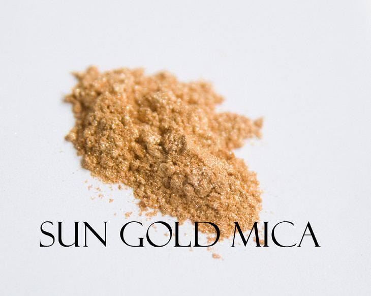 """Think """"A day at the beach natural with a hint of light gold to glam things up"""" and you have Sun Gold Mica. Leave it alone or mix it in for that barely there gold."""