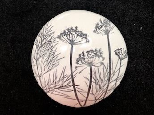 Black & White Ceramic Button. Stunning hand made ceramic button with NZ wildflower imprint by Auckland artisit Robyn Kunin.  Each button is unique and can be hung individually or as a group. Approximate measurements: 9cm dia.