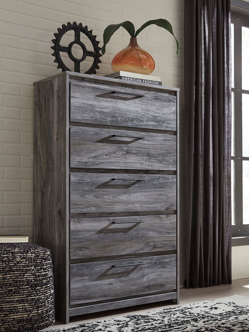 The Baystorm Gray Five Drawer Chest Available At Jake S