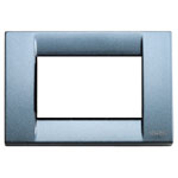 A shiny light grey blue Classica cover plate. Square. sharp corners. Hollow center. On a white background