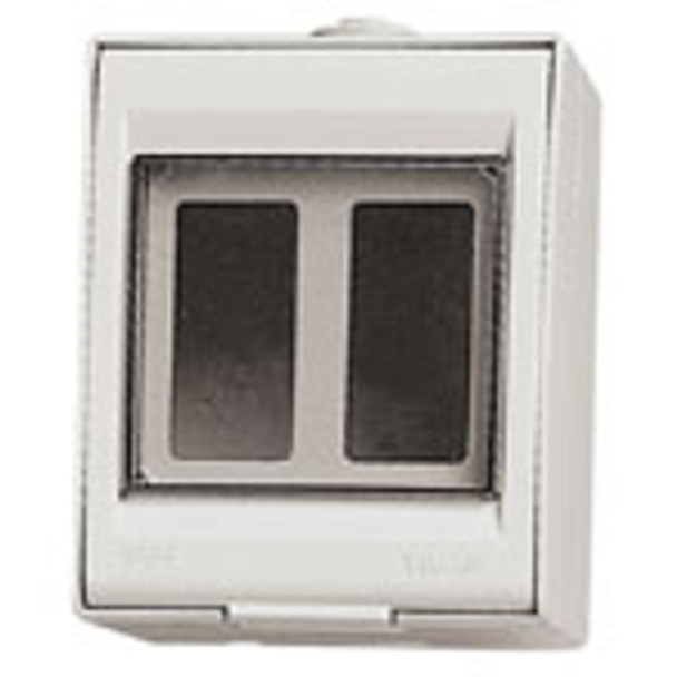 A white square box. a clear lid with 2 small boxes on the inside.
