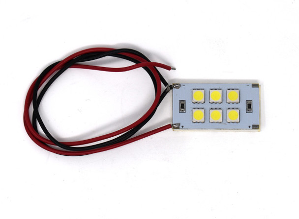 Atlas 6SMD-5050 White.  A rectangle with yellow square lights on it. Grey board. With red and black wire coming from it. On a white background