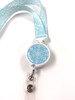 Snowflake ribbon lanyard with detachable badge reel