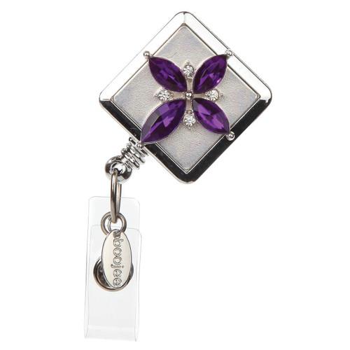 Purple cross on silver id badge reel