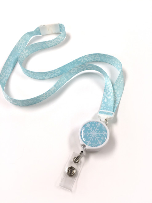 Snowflake ribbon lanyard in light blue with white snowflakes