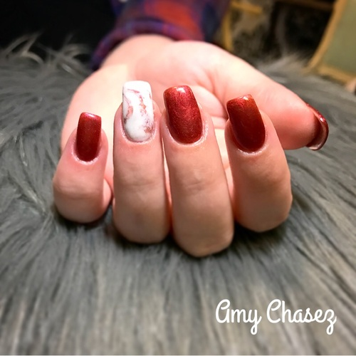 Pigment #1305 was used for this set. The white nail was done with our SO Simple hard white gel and marbled with the 1305 pigment.