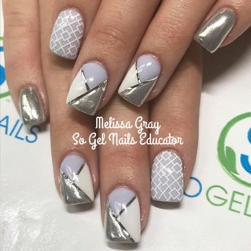 SO Gel Nails Educator Melissa Gray used color pigments #117 mixed with a touch of pigment white #116. Also, used SO Gel Nails chrome powder along with striping tape and design tape.