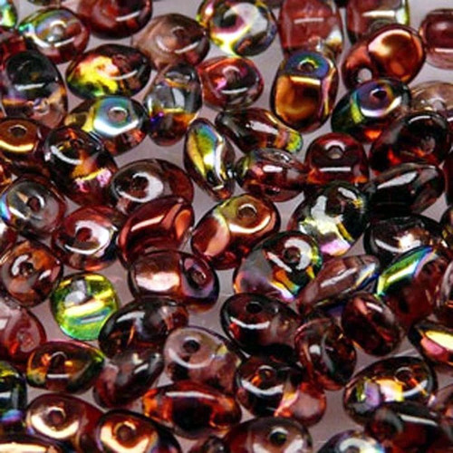 Super Duo seed beads work great for both embroidery and weaving, especially good for Peyote stitch. SuperDuos feature a unique oval diamond shape that widens just a little bit between the two holes and tapers to nice rounded ends. These beads are great any time its necessary to have perfect precision in your design. SuperDuo seed beads sold in 25 gram quantities, so there's always enough.