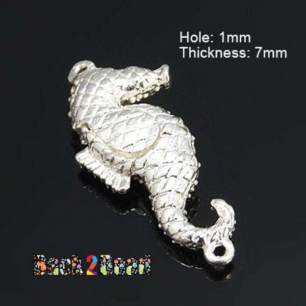 Alloy Rhinestone Magnetic Clasps, Sea Horse, Silver Color Plated Size: about 42mm long, 19mm wide, 7mm thick, hole: 1mm.  These clasps have two parts which are made up of brass and positive and negative poles of the magnets respectively inside and thus are able to absorb each other. Magnetic clasps with rhinestones on its surface are decent shiny and pretty. In a way, it is not just a clasp but a decoration.They are used for the necklace, bracelet and other jewelry project.