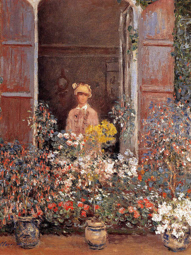 Camille At The Window by Claude Oscar Monet