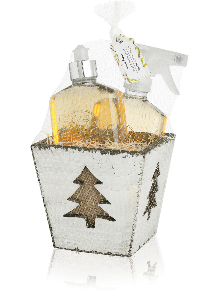 container with tree motif holding two bottles: one a cleaning liquid, one a dish soap