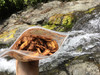 Organic banana chips dusted with sweetened dark cocoa, sea salt, and peanut powder