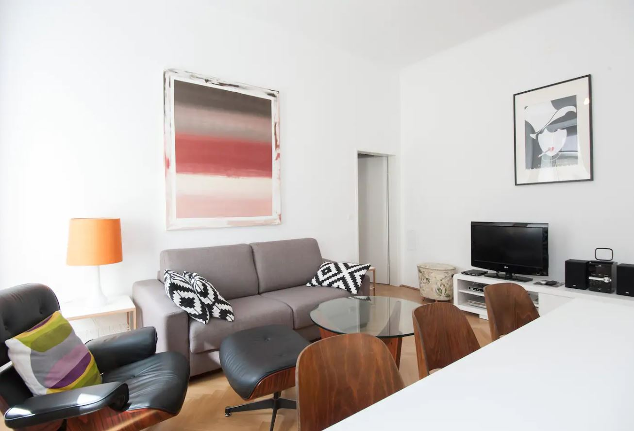 Eames Lounge Chair Living Room modern airbnbs touting our eames lounge chair replica - that