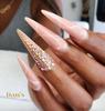 Stiletto nail design using desert sand cover