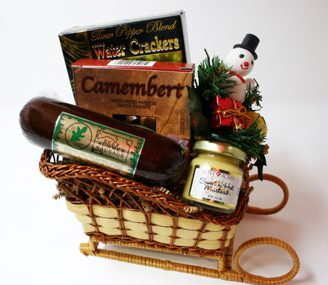 Gift 118 You Sleigh Me! A hand made Willow sleigh holds delicious gourmet foods. This gift includes 5oz Northwoods All Beef Summer Sausage, 3.75oz Camembert Cheese spread, 1.4oz jar of mustard and 2oz of Water Crackers.