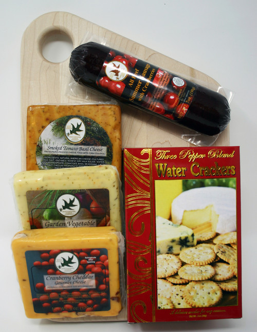 Gift 529 Cheese and Sausage Slant Board Gift Maple.  American Made Maple Hardwood slant cutting board made by persons with disabilities, with Cranberry Summer sausage, Smoked Tomato Basil Cheese, Garden Vegetable Cheese and Cranberry Cheddar cheese and Three Pepper Water Crackers.  Gift assembled by persons with disabilities