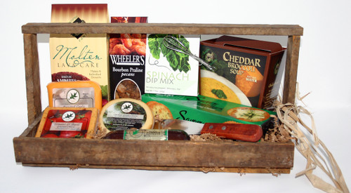 Gift 524 Lathem Wooden Tray Gourmet Food Gift. This repurposed wooden Tobacco Lathem tray tote gift contains delicious gourmet foods sure to please.  Tomato Basil Cheese, Roasted Garlic Cheese, Smoked Gouda Cheese, Northwoods Cheese All Beef Summer Sausage, Plentiful Pantry Molten Lave Cake, Wheelers Bourbon Praline Pecans, Spinach Dip Mix, Cheddar Broccoli Soup Mix, Elki Spring Onion Crackers, Spreader knife and beautifully packaged for your enjoyment.