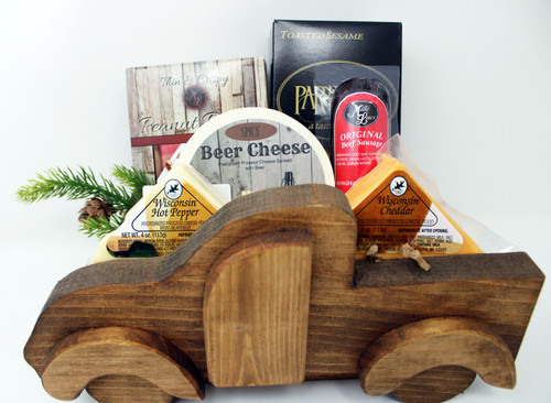 Gift 537 Trucking Cheese Gift, Rustic Wraps Wooden Truck Gift, This wooden truck in made in Wisconsin by Persons with Disabilities.   Contains 4oz Hot Pepper Cheese,  4oz Cheddar Cheese,  5oz Northwoods Cheese all Beef Summer Sausage, 2oz Partners Cracker Toasted Sesame, 6oz Spicy Beer Cheese Spread, and ML Peanut Brittle.