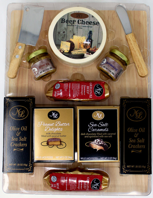 ML7185 Spicy Beer Cheese Delight $29.50 each * 6 0z.  Spicy Beer Cheese Hoop * 2 - 1.4oz. Beer Mustard * 2 - 3 oz Summer sausage * 2 - .55 oz Olice Oil and Sea Salt Crackers * 2 oz Peanut Butter Delights * 2 oz Sea Salt Caramels * Mini Cleaver * Cheese Spreader * 14 x 10.5 Cutting Board.