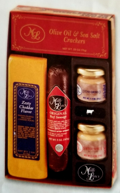 ML7038 Deli Delight Gift $15.00 Included in Gift: * Original Beef Summer Sausage  |  5.0 oz * Zesty Cheddar Cheese Bar  |  4.0 oz * Stone Ground Mustard  |  1.4 oz *  Sweet N Hot Mustard  |  1.4 oz  * Olive Oil & Sea Salt Crackers  |  .55oz *