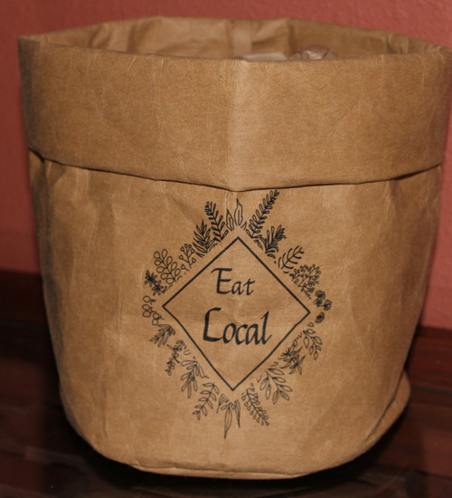 EL001 Eat Local Washable Paper Bag $12.95 each .  Eat Local Washable Paper Bag Comes flattened and you will need to fold down 2 to 3 times to decide on the height you would like the bag to be.    After being folded down they are about 7 inches high and 6 inches wide...  Add a couple of inches if you don't want them folded down at the top.