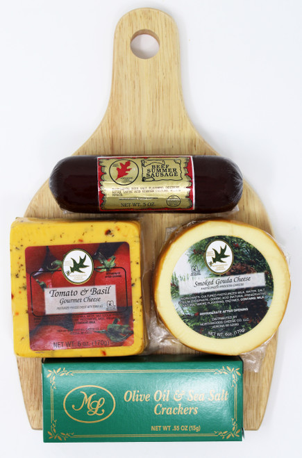 ML7187 Cheese Sensations Gift Containing Wide Wooden Handle Cutting board, 6oz of Northwoods Cheese Tomato Basil Cheese, 6oz of Northwoods Cheese Naturally Smoked Gouda Cheese, 5oz of Northwoods Cheese All Beef Summer Sausage and .55oz of Mille Lacs Olive Oil and Sea Salt Crackers, all decoratively assembled by Persons with Disabilities.