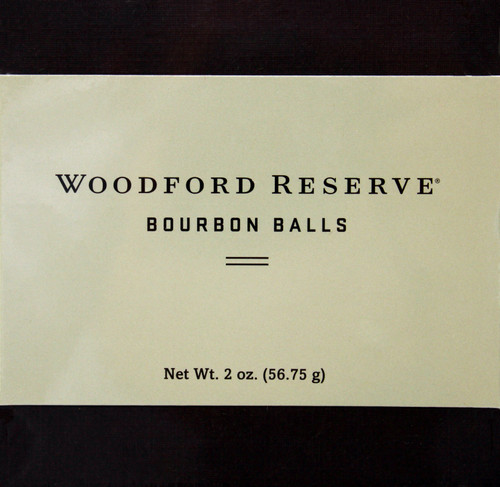 RH004 2oz Woodford Reserve Bourbon Balls 4 piece For years Bourbon Balls were a little known Southern delicacy. Ruth Hunt Candies worked to perfect the craft of making the perfect Bourbon Ball. Nearly 20 years ago, at the eve of the world's love affair with Bourbon, Ruth Hunt Candies partnered with one of the finest bourbons ever produced: Woodford Reserve® Kentucky Straight Bourbon Whiskey. Adding a small amount of this famous Bourbon to our fondant of real cream and dairy butter, the perfect Bourbon Ball was formed. Dipped in rich chocolate and topped with a perfect pecan, these Bourbon Balls have gained a reputation of excellence. That's why they are preferred by discriminating tastes across the country.