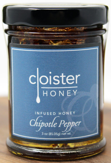 "CH014 3oz Chipotle Pepper Infused Honey Cloister This natural honey was created for the enjoyment of our Tex-Mex and tequila friends.  It carries a great 1-2-3 kick! Heat, sweet, and a ""is the barn on fire?"" smoky flavor.  You can only get this from real red and black chipotle peppers. Add to your favorite BBQ sauce instead of liquid smoke Drizzle over pulled pork, brisket or as a final glaze on one of our summer-time favorites: beer-can chicken Bring some big flavors by adding to store-bought salsa"