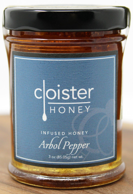 "This raw honey is sure to add a little spice to your life. The first question we always get is ""so what is an Arbol pepper?""  Oh you mean the Chile de árbol? Affectionately known as an Arbol pepper, it's of Mexican descent, has a Scoville value of 30,000 and is similar to the Jalapeño and Cayenne peppers.  The Arbol Pepper Infused honey, unlike our smoky Chipotle Infused honey, keeps it simple.  It's simply sweet with a kick of heat! Easy appetizer idea: drizzle over cheeses like Parmesan, Camembert or fresh Mozzarella Brush on grilled seafood (shrimp, scallops) just before removing from the heat Create a delicious salad dressing:  2 Tbsp Arbol Pepper Infused Honey + 2 tsp soy sauce + 1 Tbsp sesame oil + 1/4 cup oil.  Toss with greens, grilled chicken and Asian noodles. Saute or roast fresh green beans or asparagus - toss with Arbol Pepper Infused Honey before serving"