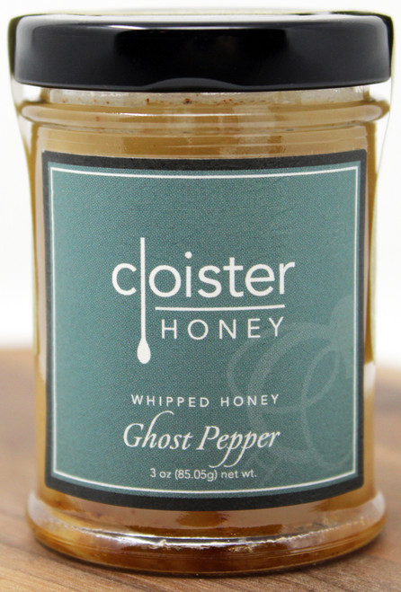 CH016 3oz Ghost Pepper Whipped Honey Cloister  This is not your average raw honey. Everyone knows that guy ... brother-in-law, friend, uncle ... that douses everything in Sriracha. No flavor too big, no hot sauce too scary for him to try.  Our Whipped Honey with Ghost Pepper will let you go along for the ride. Don't let the name fool you - the flavor here is complex: savory with a nice sting of heat.   Use as a spread on sandwiches and wraps Glaze on chicken wings Add to your favorite BBQ sauce for added heat Makes a great present for that brother-in-law that enjoys a challenge