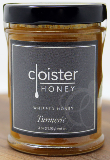 CH019 3oz Turmeric Whipped Honey Cloister  It's almost too pretty to eat. The deep orange and golden yellow glow of turmeric pairs beautifully with our wildflower honey. Hailed globally for its many health benefits, turmeric is said to provide relief for many ailments from joint pain to digestive issues. The pungent flavor of this spice is softened by the thick and creamy texture of our whipped honey. No matter what you pair with this sweet spread, it adds an earthy yet vibrant appeal to any dish. Smear over fresh bread or pita crackers Stir in with sautéed vegetable, bean or rice dishes Brush onto pan-seared chicken, cast-iron pork chop, or roasted lamb