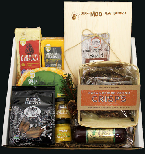 """MOO601 Udderly MOOriffic Gift - Free Shipping This is a natural cheese refrigerated product.    This gift contains:  PD2 2oz East Shore Dipping Pretzels  Northwoods Cheese 5oz All Beef Summer Sausage Green Label  1.25oz Honey Acres Honey Hot Mustard  1.25oz Honey Acres Honey Dill Mustard  6oz Potter's Crisps Caramelized Onion  8oz Wild Morel & Leek Jack Cheese  8oz Medium Cheddar Meister Cheese World Championship Winner  8oz Colby Jack Half Moon Cheese  6.5x10"""" Thumbprint Board engraved with Char-MOO-terie Logo, hardwood cutting board, made and engraved in the state of Wisconsin by persons with disabilities   This gift is shipped in a cooler box with ice to help protect it when shipping  All Gourmet Food Products Contained in the Gift are Made in the State Of Wisconsin  $99.00 with free shipping"""