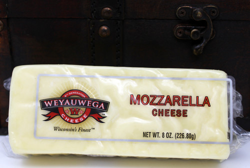 2212 Weyauwega Mozzarella Cheese Bar 8oz, Made in Wisconsin.  Mozzarella offers a delicate flavor that's milky and mild. Great for melting, its texture is soft and moist when fresh, and more dense when packaged. Whole milk mozzarella is richer in taste and is excellent for baking, while part-skim mozzarella is lighter in flavor and browns faster in the oven. Mozzarella cheese became popular in the United States after World War II, when American GIs returned home with stories of a fantastic new food they discovered in Italy … pizza. Beyond making pizza delicious, mozzarella also complements poultry, pasta, crusty breads and vegetables — especially fresh tomatoes and basil to make a Caprese salad. It pairs well with chardonnay, Chianti and pinot noir.