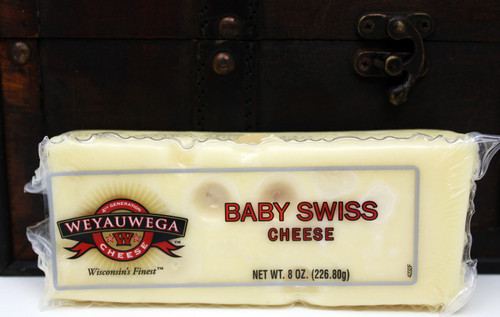 2211 Weyauwega Baby Swiss 8oz, Made in Wisconsin, Milder than traditional Swiss cheese, baby Swiss is a semi-soft cheese with a slightly sweet, buttery flavor. It's origins stem from mid 19th century America, when Swiss immigrants began making the cheese with milk from neighboring Amish family farms. Baby Swiss has a shorter curing time than traditional Swiss, which is the cause of its smaller holes and milder taste. This cheese is perfect for sandwiches, fondues, omelets, quiche and pasta. It also pairs well with sweet fruits and berries, croissants, muffins, and wines like chardonnay and white zinfandel.