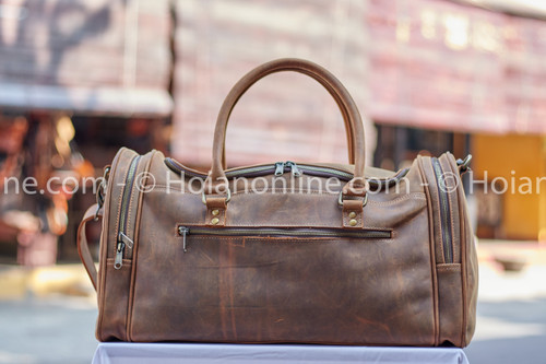 Classic styling meets rugged good looks in this beautiful natural leather  duffel bag