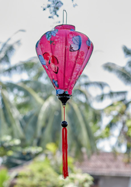 100% Handmade Light Pink with Butterflies patterned Silk Lantern in Medium Teardrop style, the symbol of Hoi An. Perfect Decoration for Indoor or Outdoor use.