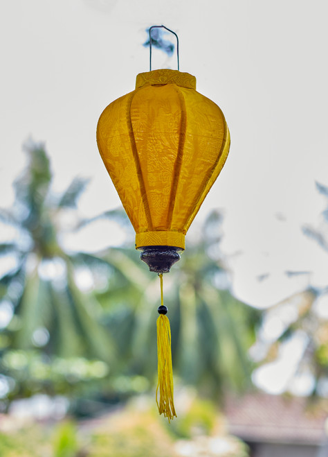 100% Handmade Solid Matte Yellow patterned Silk Lantern in Small Teardrop style, the symbol of Hoi An. Perfect Decoration for Indoor or Outdoor use.