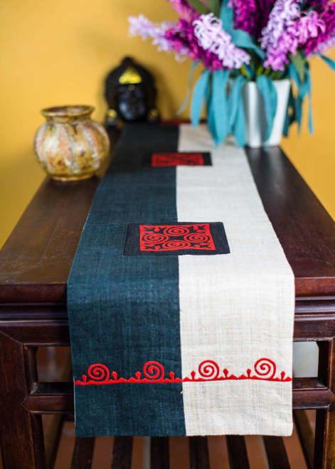 "With a striking black and white tone that invokes the principles of Yin and Yang (or ""Yeeb and Yaj"" in Hmong cosmology) where darkness and brightness interact, this attractive runner will be a perfect complement to your bedroom or living room."