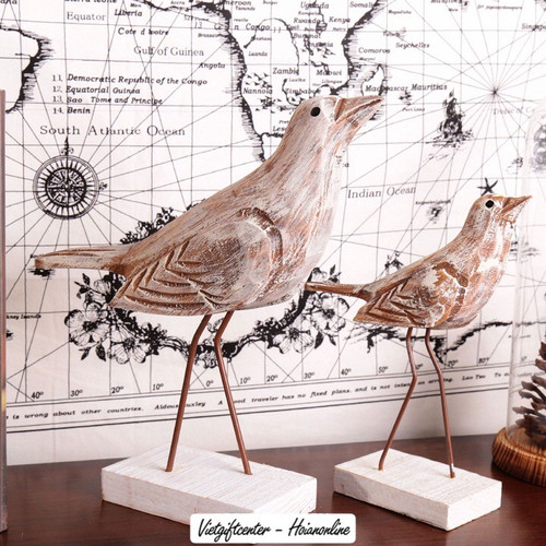 A pair of wooden pigeons